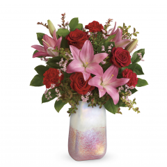 "DiBella Flowers & Gifts Las Vegas - This bouquet features red roses, pink asiatic lilies, red carnations, pink limonium, red huckleberry, and lemon leaf. Delivered in a Pretty In Quartz vase. Approximately 16 1/2"" W x 21"" H"