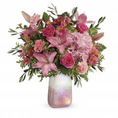 "DiBella Flowers & Gifts Las Vegas - This feminine bouquet features light pink hydrangea, hot pink roses, pink asiatic lilies, pink alstroemeria, light pink carnations,  leatherleaf fern,and lemon leaf. Delivered in a Pretty in Quartz vase. Approximately 22"" W x 23"" H"