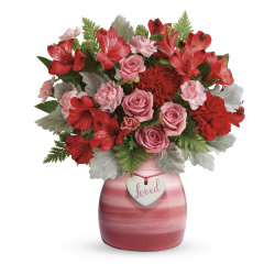 "DiBella Flowers & Gifts Las Vegas - This bouquet features pink spray roses, red alstroemeria, red carnations, pink miniature carnations, and leatherleaf fern. Delivered in a Playfully Pink vase. Approximately 11 1/2"" W x 13"" H"
