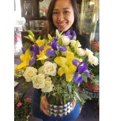 DiBella Flowers & Gifts Las Vegas - Bright iris lilies and sprays in a very cool keepsake vase