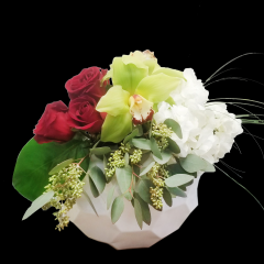 DiBella Flowers & Gifts Las Vegas - Deep red roses, Cymbidium Orchids and Hydrangea in keepsake art deco container.