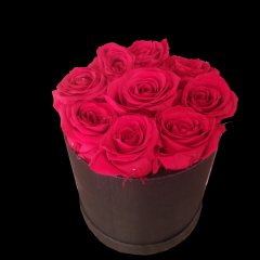 DiBella Flowers & Gifts Las Vegas - These are preserved roses that last a year or longer. Our special process preserves REAL roses to last...just like your love! Our Forever Rose preserved rose black hat box. **AMOUNT OF ROSES VARY ON SIZE OF BOX**