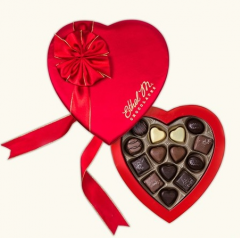 DiBella Flowers & Gifts Las Vegas - Say it beautifully! Our medium heart box wrapped in satin fabric and filled with 14 impressive chocolates! This 14-piece collection was inspired by those who get you through your day: your friends, family, and colleagues.