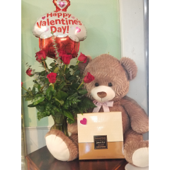 DiBella Flowers & Gifts Las Vegas - In case you were trying to impress someone... we have our BIG love rose package. One dozen of our long stemmed roses, Cupcake balloon, Large assortment of Gertrude Hawk Chocolates and GIANT Burton bear!