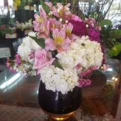 DiBella Flowers & Gifts Las Vegas - Fresh Roses, Hydbrangea, Alstromeria lilies, Carnations and more in keepsake purple and gold vase.