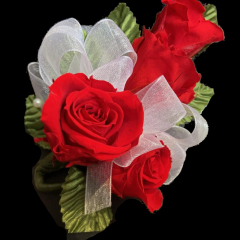 DiBella Flowers & Gifts Las Vegas - Forever Spray Rose Corsage These are preserved roses that last a year or longer. Our special process preserves REAL roses to last...just like your love! *Ribbon choice can be added to special instructions  * Does NOT include a wristlet- Wristlet must be chosen separately * Red only