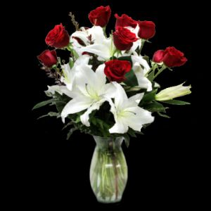 DiBella Flowers & Gifts Las Vegas - One dozen of our premium roses with lush stems of white stargazer lilies. An elegant way to show your love. Please specify color -