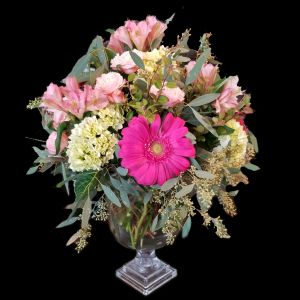 DiBella Flowers & Gifts Las Vegas - Showy pedestal vase full for fresh pink blooms. All round and beautiful. Spray roses, Gerbera Daisies, Hydrangea and Alstromeria Lilies.