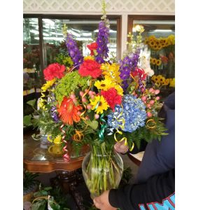 DiBella Flowers & Gifts Las Vegas - Bright fresh mix with curls of ribbon make this the perfect celebration bouquet!  All round and full of flowers! * COLORS MAY VARY DUE TO AVAILABILITY