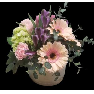 DiBella Flowers & Gifts Las Vegas - Silver keepsake cylinder filled with soft pink green and purples. Gerbera Daisies, Hydrangeas, Carnations and Alstromeria Lilies.