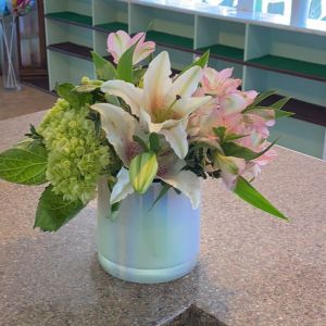 DiBella Flowers & Gifts Las Vegas - Opalescent keepsake cylinder face with hydrangeas,lilies and alstroemeria.