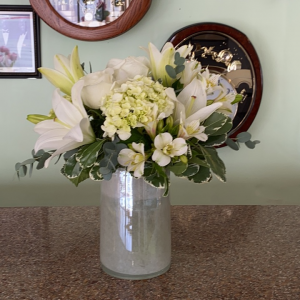 DiBella Flowers & Gifts Las Vegas - White lilies, hydrangea, alstroemerias and roses in keepsake vase