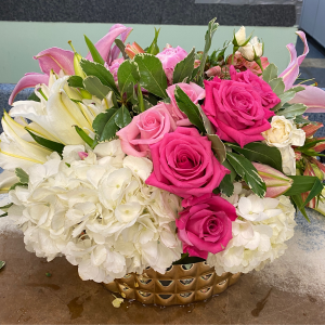 DiBella Flowers & Gifts Las Vegas - Hydrangea, roses, lilies and other seasonal blooms in keepsake vase.