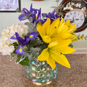 DiBella Flowers & Gifts Las Vegas - Yellow lilies, hydrangea and iris is keepsake vase. Great vase or candle holder afterwards