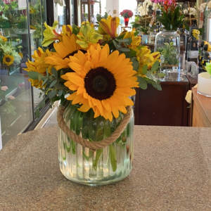 DiBella Flowers & Gifts Las Vegas - Keepsake lantern vase full of bright sunflowers and alstroemeria lilies.