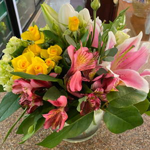 DiBella Flowers & Gifts Las Vegas - Bright mix of seasonal flowers, lilies, tulips, spray roses and more in a cylinder vase.  * flowers my vary slightly due to seasonal availability.