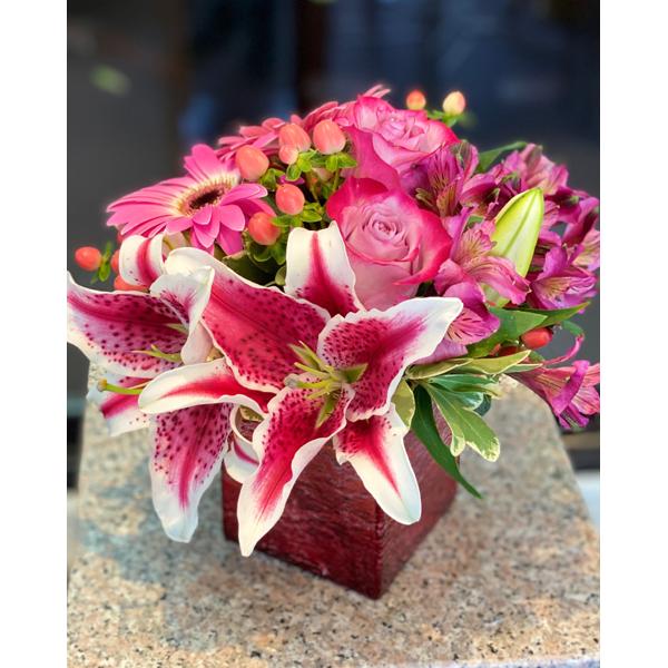 DiBella Flowers & Gifts Las Vegas - Stargazer lilies roses and more in keepsake cube.