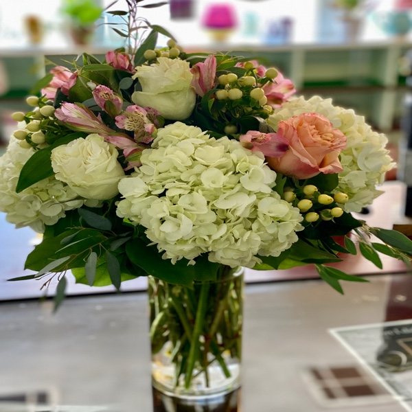 DiBella Flowers & Gifts Las Vegas - Fresh full hydrangea, alstroemeria lilies, roses and coffee bean in a clear cylinder vase.