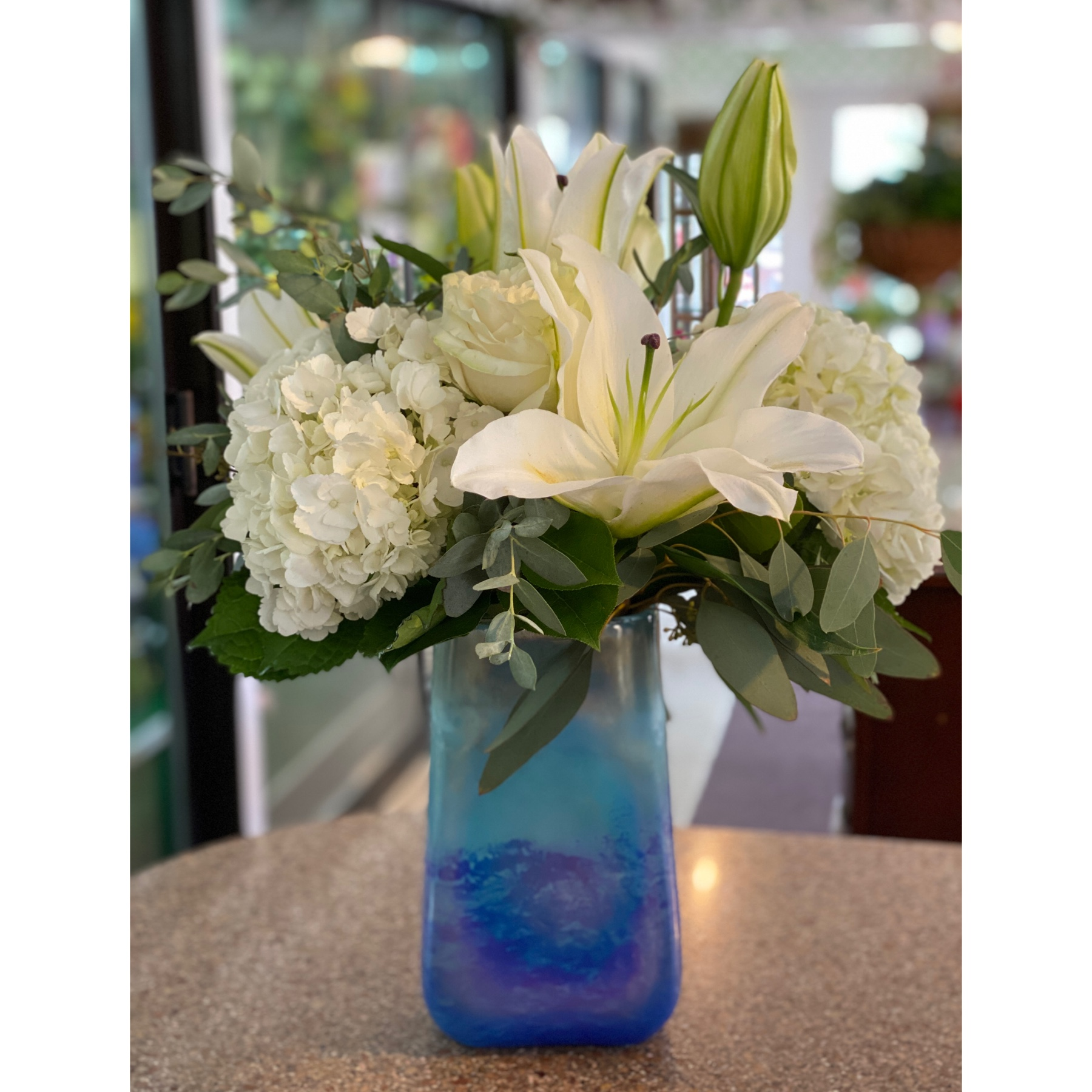 DiBella Flowers & Gifts Las Vegas - Gorgeous keepsake blue topaz vase with fresh white blooms.