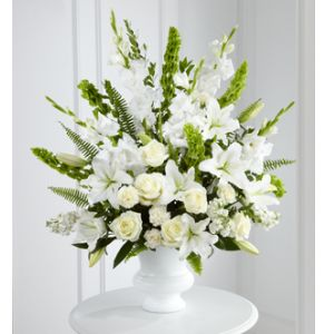 DiBella Flowers & Gifts Las Vegas - Morning Stars Arrangement is a brilliant expression of peace and soft serenity. White roses, carnations, gladiolus, stock, and Oriental lilies are accented with the bright green stems of Bells of Ireland and a gorgeous assortment of lush greens, while seated in a white designer plastic urn to create a beautiful memory.
