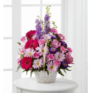 DiBella Flowers & Gifts Las Vegas - Pastel Peace Basket is a sweet and simple way to offer your sentiments. Lavender roses, fuchsia gerbera daisies, lavender daisies, purple larkspur, purple matsumoto asters, pink mini carnations and lush greens are arranged to perfection in a round whitewash handled basket to create a gift that expresses your wishes for sympathy and peace. * Basket type may vary