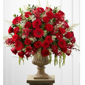 DiBella Flowers & Gifts Las Vegas - This Arrangement blooms with the magic of the love's finest moment. Red roses, white roses, orchids, red gerbera daisies and fresh myrtle are brought together in a resin urn.