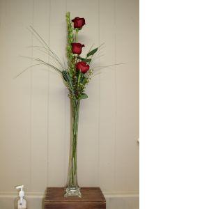 DiBella Flowers & Gifts Las Vegas - The Elegant Triple Rose Tower Budvase. Approximately 3 feet tall.
