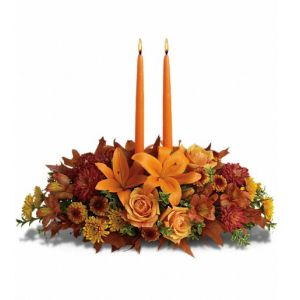 DiBella Flowers & Gifts Las Vegas - Family Gathering Centerpiece As your loved ones gather around the table, they'll bask in the warm glow of two orange taper candles surrounded by a fantastic array of fall flowers. T169-1A