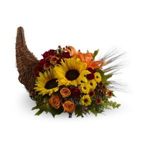 DiBella Flowers & Gifts Las Vegas - Heavenly Cornucopia What could be more heavenly than this harvest display of fresh flowers - including sunflowers, roses and Asiatic lilies - spilling from a natural cornucopia? Wonderful for Thanksgiving, and a spectacular hostess gift. * Medium version shown