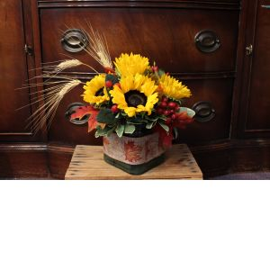 DiBella Flowers & Gifts Las Vegas - Sunflower Harvest Ribbon wrapped cube that includes Sunflowers, Hypericum Berries, Wheat and Fall leaves. Perfect for a desk top or dining room table.