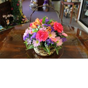 DiBella Flowers & Gifts Las Vegas - Sweet Memories of You Wicker basket full of fresh Carnations, Alstromeria Lilies and Daisies *Color tones may vary depending on availability