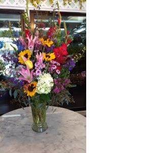 DiBella Flowers & Gifts Las Vegas - Solver of flower mayhem, awesome mom, patient and loyal friend, this bouquet was made by our manager Michelle. Bright fun mix that WILL amaze that special someone!