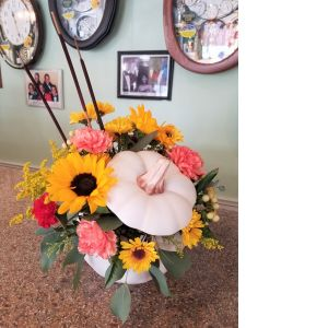 DiBella Flowers & Gifts Las Vegas - Add a touch of enchantment to your fall gatherings with this magnificent mix of autumnal sunflowers, carns and mums, gathered in a white ceramic pumpkin that's sure to be an annual décor favorite!