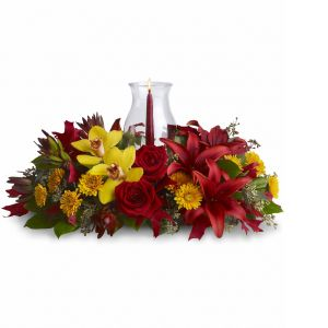 DiBella Flowers & Gifts Las Vegas - Graceful. Glowing. Gorgeous. This stunning centerpiece will make setting the mood and the Thanksgiving table nothing less than perfect. Fall's most fabulous flowers surround a candle inside hurricane glass. Now that's true class.