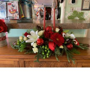DiBella Flowers & Gifts Las Vegas - The perfect holiday centerpiece for your dining table. Roses, lilies, berries and more with candles to light up your event.
