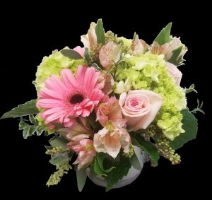 DiBella Flowers & Gifts Las Vegas - Soft pink roses, hydrangeas, alstromeria lilies and gerbera daisies in an opalescent cylinder.
