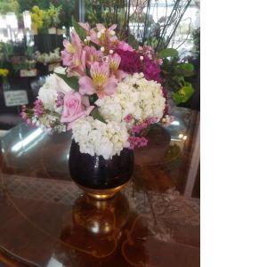 DiBella Flowers & Gifts Las Vegas - Fresh Roses, Hydbrangea, Alstromeria lilies, Carnations and more in keepsake purple and gold vase.