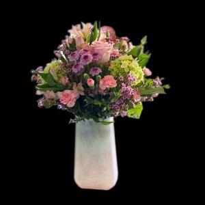 DiBella Flowers & Gifts Las Vegas - Keepsake quartz pink vase full of soft blooms. Hydrangea, Roses, Alstromeria and more.