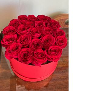 DiBella Flowers & Gifts Las Vegas - Gorgeous forever roses. 21 count. These are preserved Roses that last a year or longer. Our special process preserves real roses to last just like your love! *red only  As shown. Each piece is custom made and will be sent as pictured.