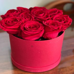 DiBella Flowers & Gifts Las Vegas - Gorgeous Forever roses and red circular hat box. 10 count. These are preserved roses that last a year or longer. Our special process preserves REAL roses to last...just like your love! *Ribbon choice can be added to special instructions  * Does NOT include a wristlet- Wristlet must be chosen separately * Red only