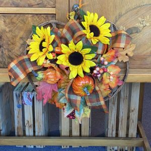 DiBella Flowers & Gifts Las Vegas - Silk sunflowers berries and pumpkins in a adorable pumpkin shaped wreath. Perfect to bring in fall.