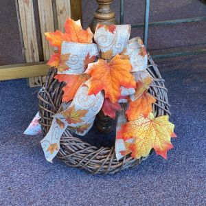 DiBella Flowers & Gifts Las Vegas - This adorable silk and grapevine wreath look great on your door!