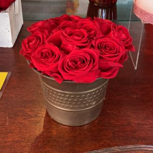 DiBella Flowers & Gifts Las Vegas - Our beautiful forever roses in a copper colored  metal base.