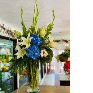 DiBella Flowers & Gifts Las Vegas - Blues and cream in tall trumpet vase.