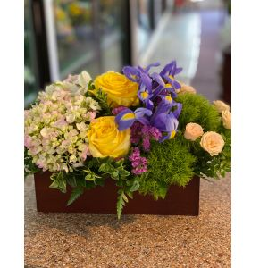 DiBella Flowers & Gifts Las Vegas - Bamboo box full of bright beautiful blooms. Roses, hydrangea and more.
