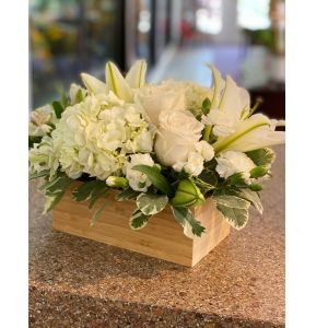 DiBella Flowers & Gifts Las Vegas - Soft white blooms including white, roses, lilies and hydrangea and more in bamboo base.