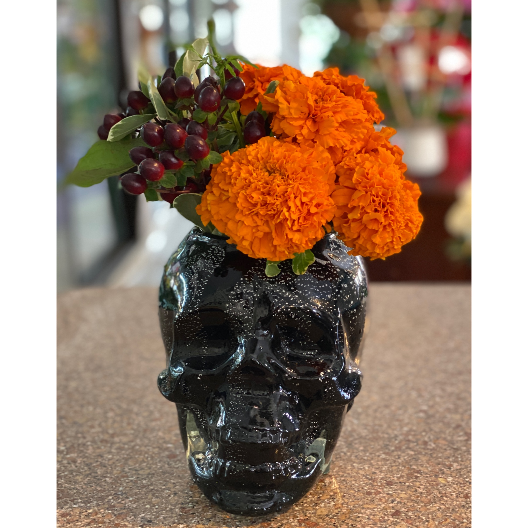 DiBella Flowers & Gifts Las Vegas - Our very cool black skull vase full of fresh marigolds and dark red coffee bean. Perfect to celebrate the holiday.
