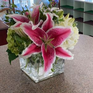 DiBella Flowers & Gifts Las Vegas - Fresh stargazer lilies and green and white hydrangea in a clear glass cube