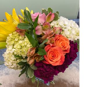 DiBella Flowers & Gifts Las Vegas - Mixed cube of bright blooms. Roses lilies hydrangea and more.  *colors may vary