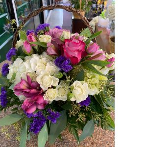 DiBella Flowers & Gifts Las Vegas - Roses hydrangea and other lush fresh blooms in wicker basket.